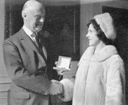 1966 Mary Place receives award after robbery attempt at branch MBM-Su66P38.jpg
